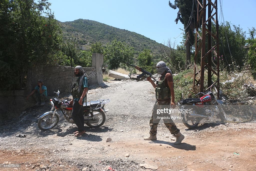 Syrian opposition member stands guard after They took control Kinsabba district of Lattakia, Syria on July 1, 2016.
