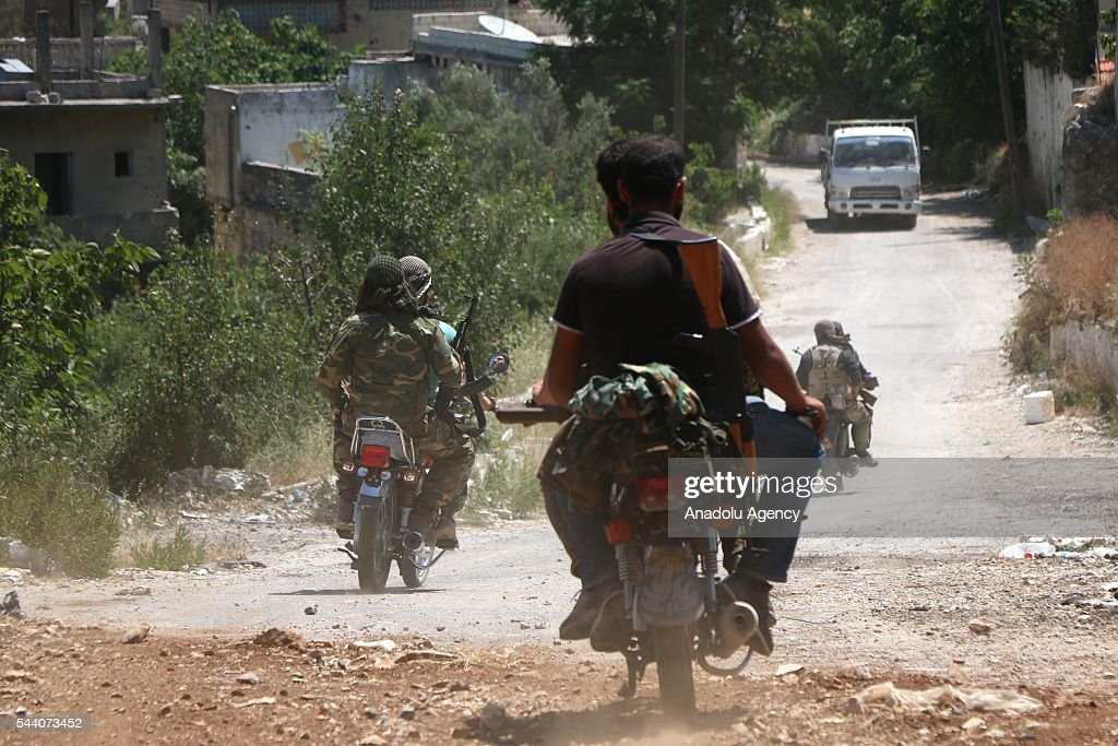 Syrian oppositions are seen after They took control Kinsabba district of Lattakia, Syria on July 1, 2016.