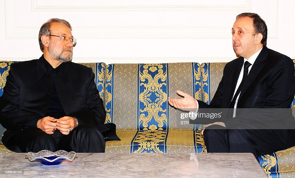 Syrian Parliament speaker Mohammed Jihad al-Laham (R) meets with his Iranian counterpart Ali Larijani in Damascus on November 23, 2012 . Iranian speaker of parliament Ali Larijani left Tehran to start a regional tour of Syria, Lebanon and Turkey, Mehr news agency said. AFP PHOTO/STR