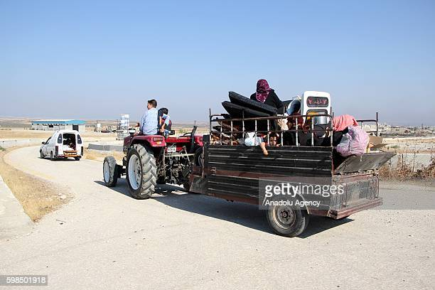 Syrian people are seen as they leave the opposition controlled Soran district after the war crafts belonging to the Assad Regime forces' carried out...