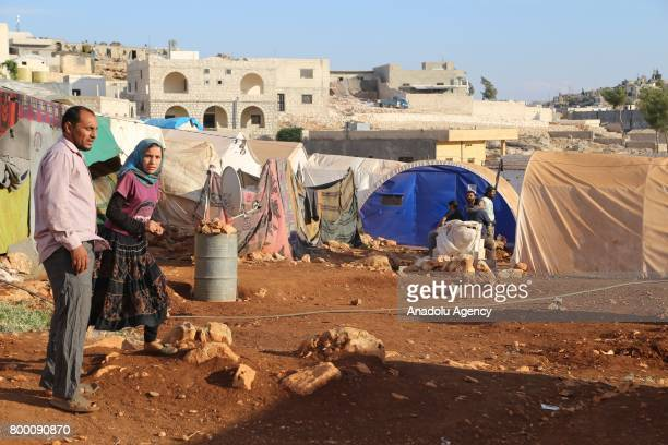 Syrian people are seen outside of their tents during Muslim's holy month of Ramadan in Idlib Syria on June 23 2017 Ahead of Eid al Fitr Syrian people...
