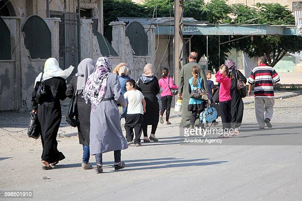 Syrian people leave the opposition controlled Soran district after the war crafts belonging to the Assad Regime forces' carried out an airstrike over...