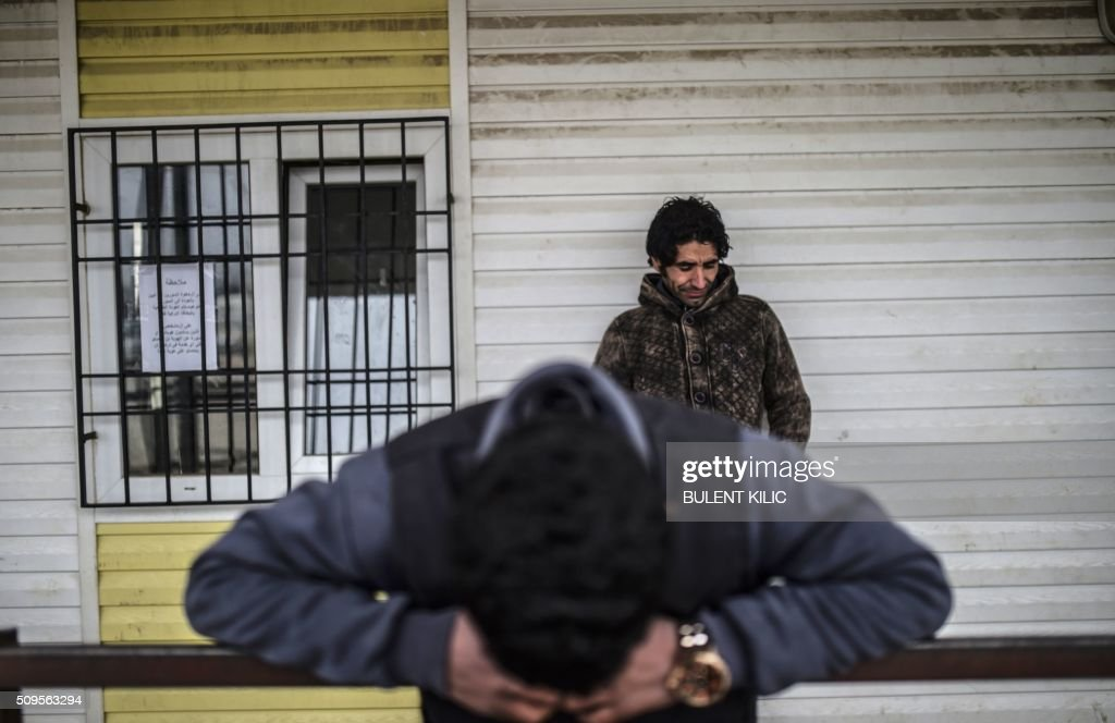 Syrian people wait in front of the Oncupinar crossing gate to go back to Syria, near the town of Kilis, in south-central Turkey, on February 11, 2016. Russia said on February 11 it was ready to discuss a ceasefire in Syria as foreign ministers gathered in Munich in a bid to kick-start peace talks derailed by the regime onslaught on the besieged city of Aleppo. The UN said 51,000 Syrians had fled the bombardment by government forces, backed by Russian bombers and Iranian fighters, that has left the opposition there virtually surrounded. KILIC