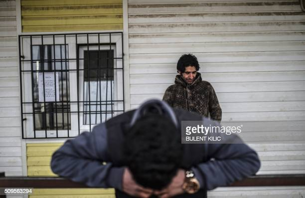TOPSHOT Syrian people wait in front of the Oncupinar crossing gate to go back to Syria near the town of Kilis in southcentral Turkey on February 11...