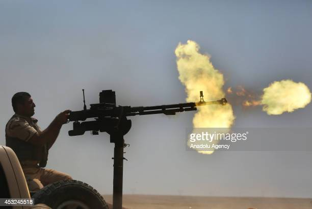 Syrian People's Protection Units members fight against Islamic State of Iraq and the Levant in Rabia town Mosul Iraq on August 6 2014 YPG members and...