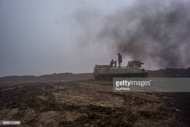 Syrian People's Protection Units members in a tank in frontline of Raqqa on January 7 2016 fight against the Daesh