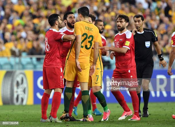 Syrian players confront Australia's Tomas Rogic as Australia defeats Syria in their 2018 World Cup football qualifying match played in Sydney on...