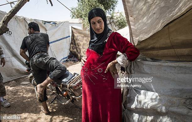 Syrian pregnant woman is seen at Atmeh refugee camp in Idlib Syria on May 19 2015 More than 60 thousand refugees fled their homes due to the attacks...