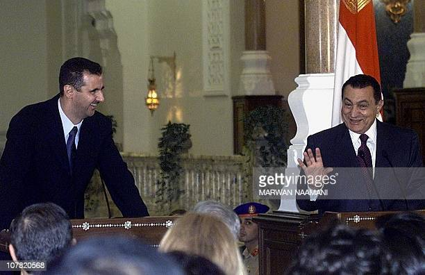Syrian President Bashar alAssad and his Egyptian counterpart Hosni Mubarak laugh during their joint press conference in Cairo 02 October 2000 Mubarak...