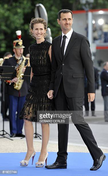Syrian President Bashar alAssad and his wife Asma alAssad arrive for a diner at the Petit Palais after attending Paris' Union for the Mediterranean...