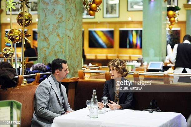Syrian president Bashar alAssad and his wife Asma are seen at the Coupole restaurant in Paris on December 10 2010 AlAssad is on a twodays official...