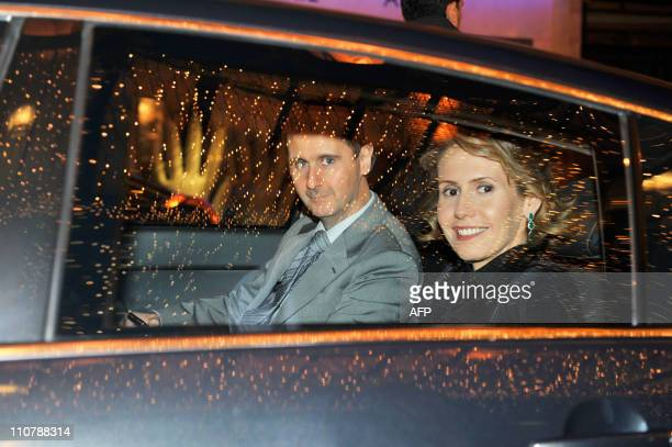 Syrian president Bashar alAssad and his wife Asma are seen in a car on December 9 2010 in Paris AlAssad is on a twodays official visit to France AFP...
