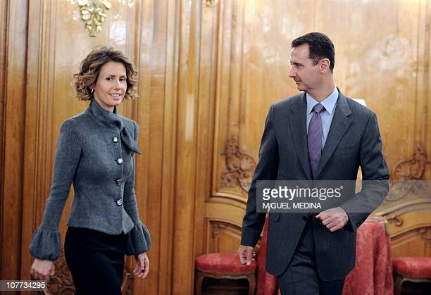 Syrian president Bashar alAssad and his wife Asma arrive to deliver a speech for the Syrian Community on December 9 2010 in Paris AlAssad is on a...