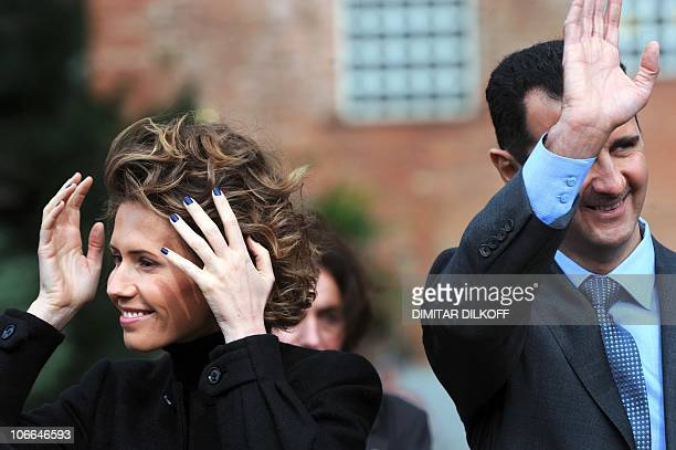 Syrian President Bashar alAssad and his wife Asma attend on November 9 2010 an official welcoming ceremony in Sofia It is the first visit to Bulgaria...