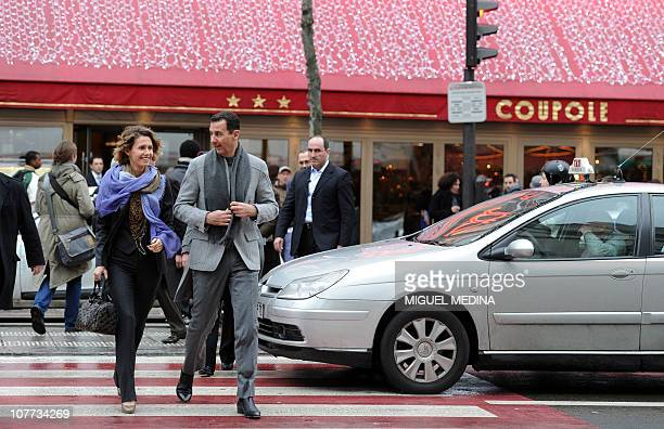 Syrian president Bashar alAssad and his wife Asma walk in a street of Paris on December 10 2010 AlAssad is on a twodays official visit to France AFP...