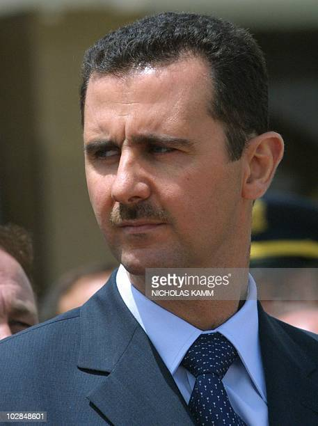 Syrian President Bashar alAssad attends the departing ceremony of Pope John Paul II at Damascus airport 08 May 2001 at the end of the pontiff's visit...