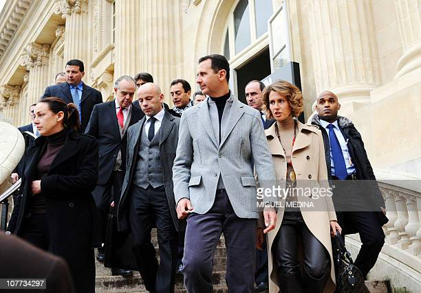 Syrian President Bashar alAssad his wife Asma and French Culture Minister Frederic Mitterrand leave the Grand Palais after they visit the exhibition...