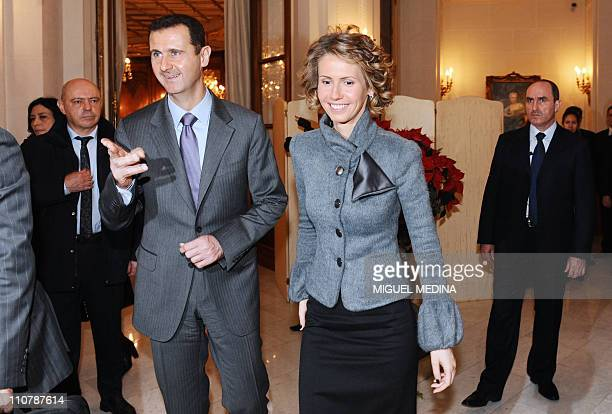 Syrian President Bashar alAssad his wife Asma visit the exhibition dedicated to French painter Claude Monet at the Grand Palais on December 11 2010...