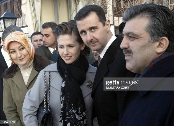 Syrian President Bashar alAssad his wife Syrian first lady Asma AlAssad Turkish foreign minister Abdullah Gul and his wife Hayrunnisa Gul are seen...