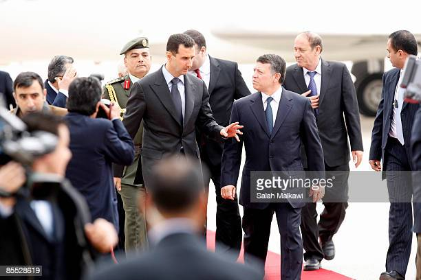 Syrian President Bashar alAssad is received by Jordan's King Abdullah II upon his arrival on March 20 2009 in Amman Jordan