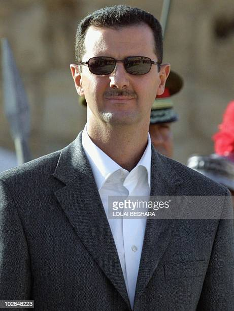 Syrian President Bashar alAssad is seen during an official ceremony at his palace in Damascus 20 October 2003 US President George W Bush signed...