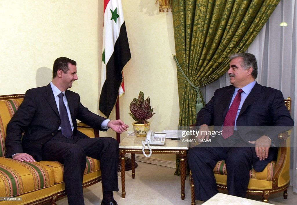 Syrian President <a gi-track='captionPersonalityLinkClicked' href=/galleries/search?phrase=Bashar+al-Assad&family=editorial&specificpeople=206274 ng-click='$event.stopPropagation()'>Bashar al-Assad</a> (L) meets with Lebanese Prime Minister Rafic Hariri in Doha 11 November 2000. The two leaders are in the Qatari capital to attend the Organization of the Islamic Conference (OIC) summit which opens 12 November. AFP PHOTO/Ayman TRAWI