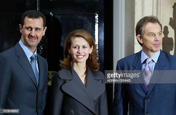 Syrian President Bashar alAssad poses with his wife Asma and Britain's Prime Minister Tony Blair outside No10 Downing Street in London 16 December...