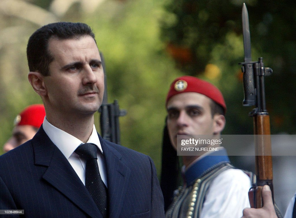 Syrian President <a gi-track='captionPersonalityLinkClicked' href=/galleries/search?phrase=Bashar+al-Assad&family=editorial&specificpeople=206274 ng-click='$event.stopPropagation()'>Bashar al-Assad</a> reviews the Greek Presidential honor guard (evzones) during a welcoming ceremoney held in Athens 15 December 2003. Greek Preisdent Costis Stephanopolous received his Syrian counterpart al-Assad who is on a three-day visit to Greece. AFP PHOTO / FAYEZ NURELDINE