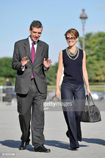 Syrian President Bashar alAssad's wife Asma alAssad is welcomed by the Louvre Museum's President Henri Loyrette before visiting the Louvre on July 13...