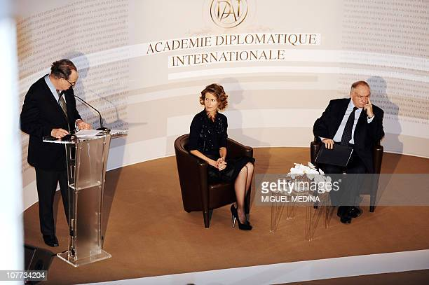 Syrian president Bashar alAssad's wife Asma and the general secretary of the International diplomatic academy JeanClaude Cousseran listen to French...