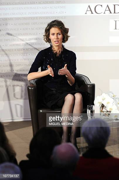 Syrian president Bashar alAssad's wife Asma gestures as she speaks during a meeting at the International diplomatic academy on December 10 2010 in...