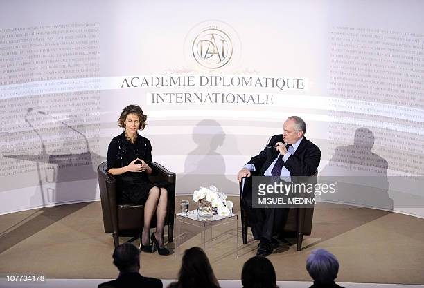 Syrian president Bashar alAssad's wife Asma speaks next to the general secretary of the International diplomatic academy JeanClaude Cousseran during...