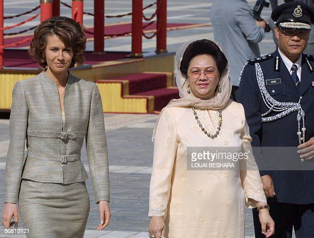 Syrian President Bashar alAssad's wife Asma welcomes Malaysia's Queen Tuanku Fauziah Tengku Abdul Rashid during an official ceremony for her and her...