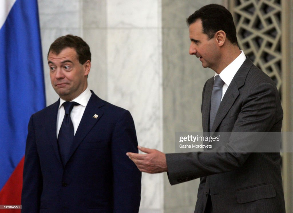 Syrian President Bashar Assad (R) receives Russian President <a gi-track='captionPersonalityLinkClicked' href=/galleries/search?phrase=Dmitry+Medvedev&family=editorial&specificpeople=554704 ng-click='$event.stopPropagation()'>Dmitry Medvedev</a> (L) May 10, 2010 in Damascus, Syria. Medvedev is on a two-day state visit and will hold talks focusing on the bilateral relationship between Syria and Russia, amongst other matters.