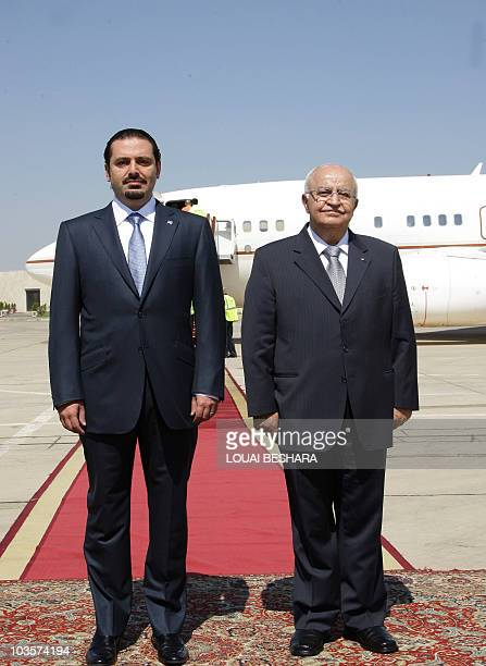 Syrian Prime Minister Mohammed Naji Otri greets Lebanese Prime Minister Saad alHariri upon his arrival at Damascus airport on July 18 during an...