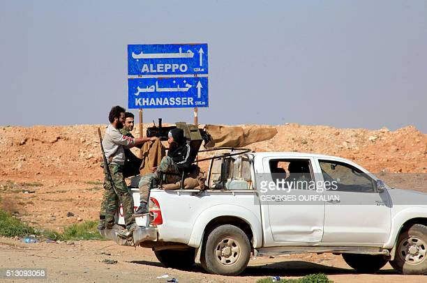Syrian progovernment forces advance on a road through the town of Khanasser which is the sole link between governmentheld areas in and around Aleppo...