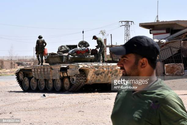Syrian progovernment forces hold a position near the village of alMaleha in the northern countryside of Deir Ezzor on September 9 during the ongoing...