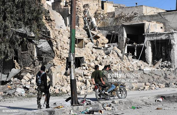 Syrian progovernment forces patrol the Bab alHadid neighbourhood in Aleppo's Old City on December 8 after taking control of the area President Bashar...