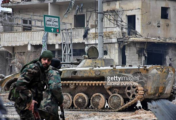 TOPSHOT Syrian progovernment forces patrol the northern embattled city of Aleppo on December 14 2016 Shelling and air strikes sent terrified...