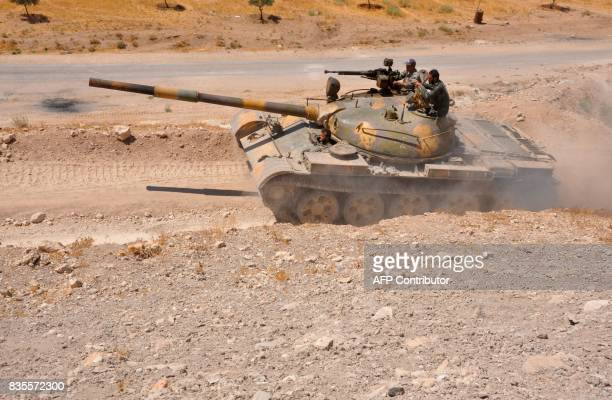 A Syrian progovernment forces tank is seen in the Salamiyah city some 33 kilometres southeast of Hama on August 19 during an offensive against...