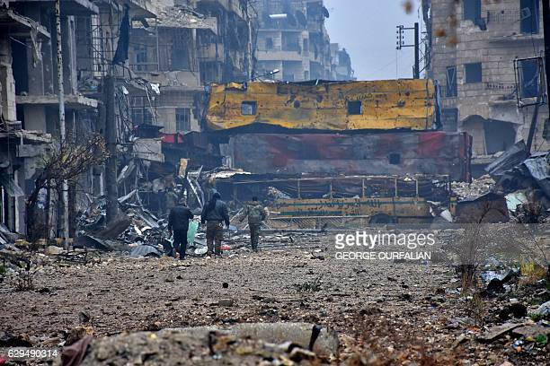 TOPSHOT Syrian progovernment forces walk in Aleppo's Bustan alQasr neighbourhood after they captured the area in the eastern part of the war torn...