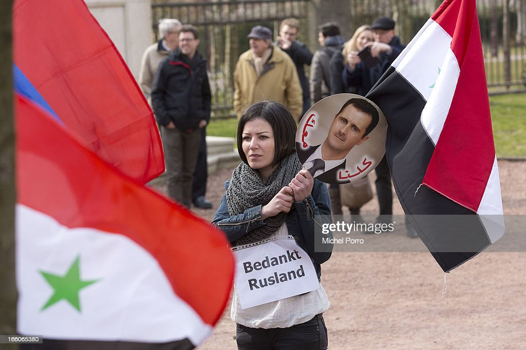 . A Syrian protester thanks Russia for its support of her home country as President Putin meets Queen Beatrix of The Netherlands at Tsar Peter Exhibition on April 8, 2013 in Amsterdam, Netherlands. Putin began a one-day state visit to the Netherlands at the invitation of Queen Beatrix.
