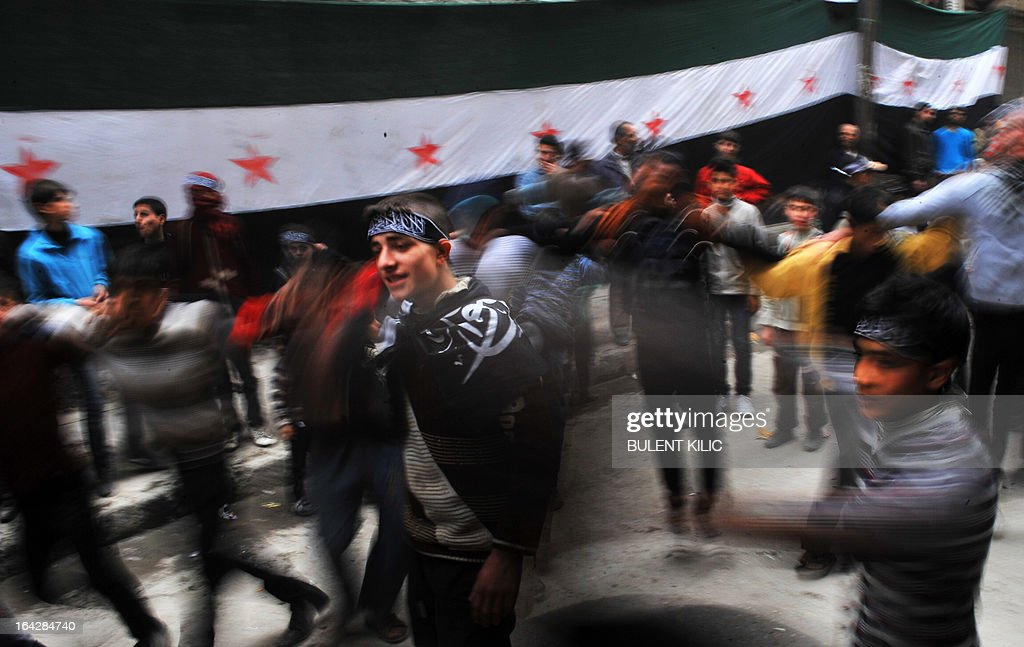 Syrian protesters dance during an anti-regime demonstration in the northern city of Aleppo on March 22, 2013. EU foreign ministers mulled a contested push by Britain and France to lift or amend a Syria arms embargo to help tip the balance in the country's more than two-year conflict.
