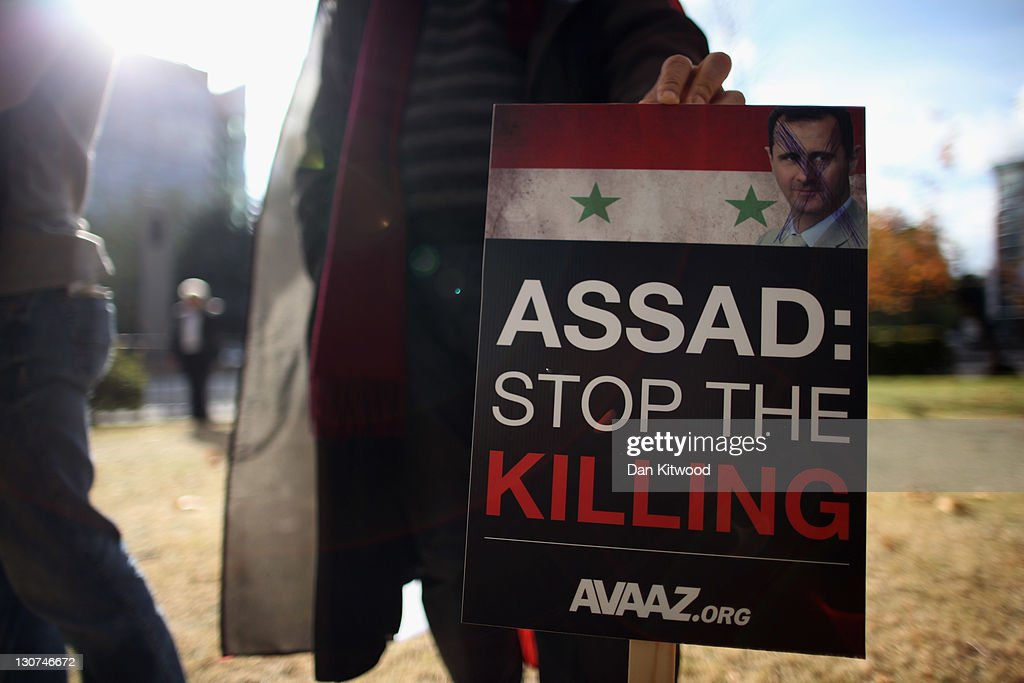 Syrian protesters make their way down Edgeware Road to the Syrian Embassy on October 29, 2011 in London, England. Amnesty International activists and Syrians living in the UK are to hold a 'No More Blood - No More Fear' rally outside the Syrian embassy to call for an end to the government crackdown in Syria, which has killed at least 3,000 people.