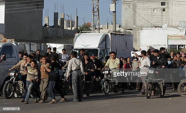 Syrian protesters march in the village of Ankhal near southern town of Daraa 100 kms south of Damascus on March 21 2011 demanding 'freedom' and an...