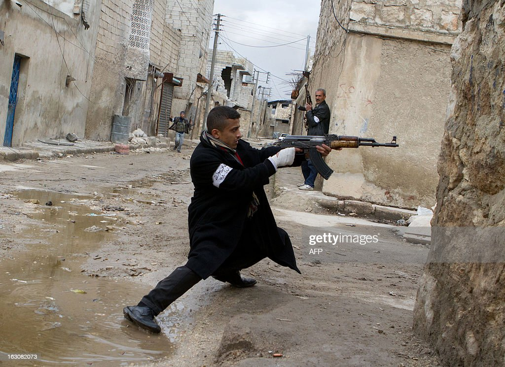 A Syrian rebel aims his weapon during clashes with government forces in the streets near Aleppo international airport in northern Syria on March 4, 2013. Syria is locked in a nearly two-year-old conflict in which the United Nations estimates that more than 70,000 people have been killed.