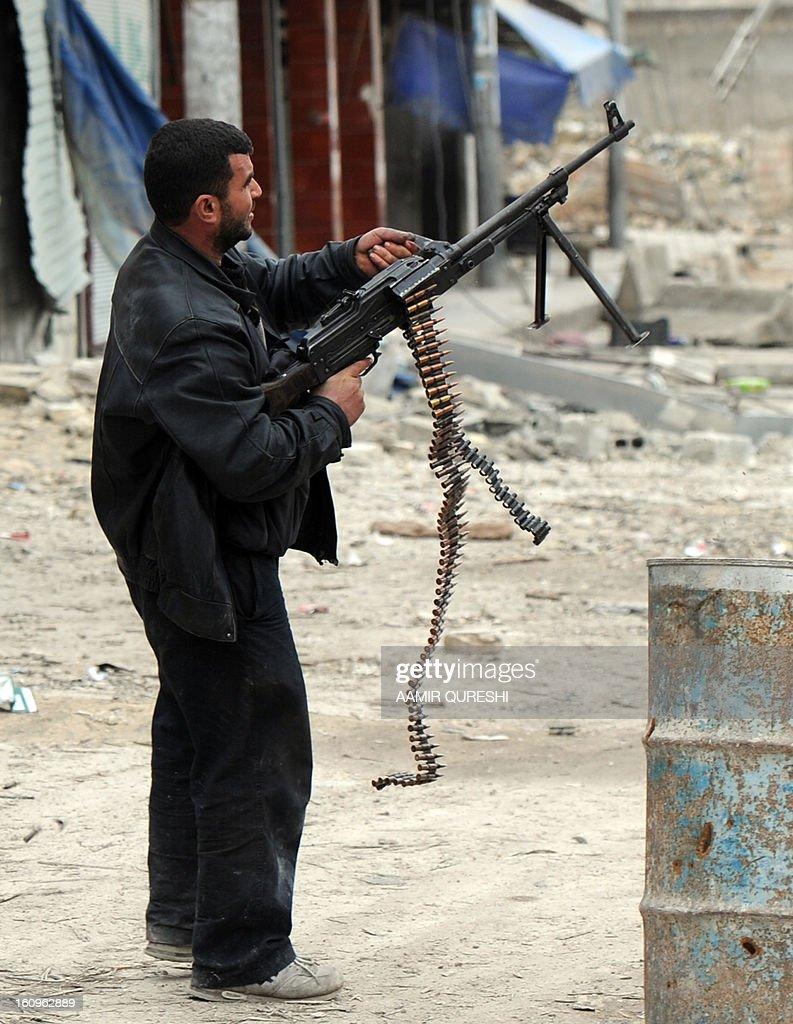 A Syrian rebel aims his weapon towards a position held by regime forces during clashes in the northern city of Aleppo on February 8, 2013. Syrian forces shelled rebel belts, the Syrian Observatory for Human Rights said, as an army offensive raged into a third straight day.