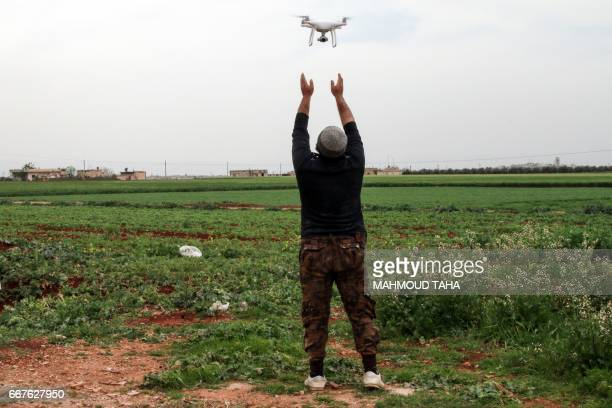 A Syrian rebel fighter flies a DJI Phantom 4 camera drone near the central Syrian rebelheld town of Talbiseh in the countryside of the central Syrian...