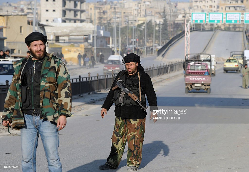 Syrian rebel fighter man a check point in Aleppo's old city on January 16, 2013. Syria's transport sector has lost 3.6 billion Syrian pounds ($391 million/294 million euros) since the uprising against President Bashar al-Assad broke out in March 2011, state media reported.