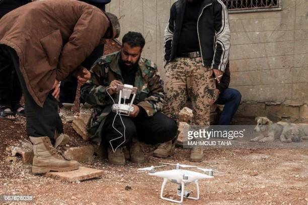 A Syrian rebel fighter operates a DJI Phantom 4 camera drone near the central Syrian rebelheld town of Talbiseh in the countryside of the central...